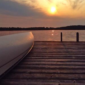 totemblaze canoe on dock at twilight